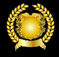 Golden heraldic shield with laurel wreath Royalty Free Stock Photo
