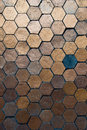 The golden hexagon with one black hexagon as pattern for background Royalty Free Stock Images