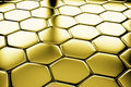 Golden hexagons flooring diagonal view metal surface shiny abstract industrial background Royalty Free Stock Images