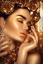 Golden holiday makeup. Golden wreath and necklace Royalty Free Stock Photo