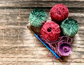 Golden hook for knitting and multicolored balls. Granny knitting. Homemade crafts Royalty Free Stock Photo