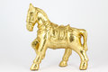 Golden horse statue on white background Stock Photography