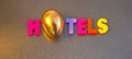 Golden hotels text hotel in colorful uppercase letters with the letter o replaced by a egg providing a possible logo for a hotel Royalty Free Stock Photography