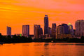 Golden hour lights on austin texas skyline gold sky sunset city with town lake or the colorado river in the foreground Royalty Free Stock Photography