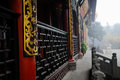 Golden inscribed plaques of chinese ancient building wooden with characters on the pillars an in the zhaojue monastery at chengdu Stock Images