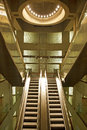 Golden interior escalator in business architecture Royalty Free Stock Photos