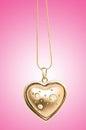 Golden jewellery against gradient Stock Photography