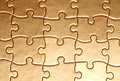 Golden jigsaw Royalty Free Stock Photo