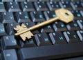 Golden key on laptop1 Stock Photos