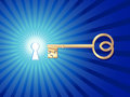 Golden key open shining keyhole Royalty Free Stock Image