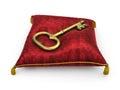 Golden key on royal red velvet pillow isolated on white backgrou background Stock Image