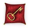 Golden key on royal red velvet pillow isolated on white backgrou background Stock Photography