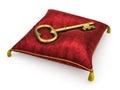 Golden key on royal red velvet pillow isolated on white backgrou background Royalty Free Stock Image