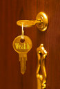 Golden key wealth abstract business concept Royalty Free Stock Photos