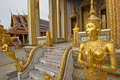 A Golden Kinnari statue in Wat Phra Kaew, Bangkok, Thailand Royalty Free Stock Photo