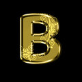 Golden letter B with floral ornament.Isolated on black.