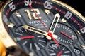 Golden, luxury men's wristwatch. Clock face close up. Royalty Free Stock Photo