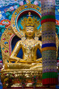 Golden maitreya a large gilded deity of the buddhist personality Stock Photography