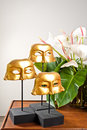 Golden masks as interior decoration wooden table Royalty Free Stock Photo