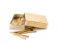 Golden matches on a white background Royalty Free Stock Photos
