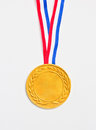 Golden medal isolated on white Stock Image