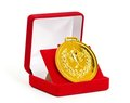 Golden medal in red gift box. Royalty Free Stock Photo