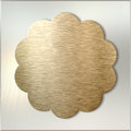 Golden metal label over brushed metal background Royalty Free Stock Photo