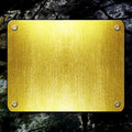 Golden metal plate on concrete wall raster artwork Royalty Free Stock Image