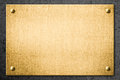 Golden metal plate or signboard on wall background Stock Image