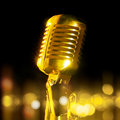 Golden microphone Royalty Free Stock Photography