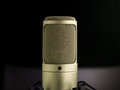 The golden microphone broadcast voice on dark background close up shoot Stock Image