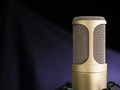 The golden microphone broadcast voice on dark background closeup shot Royalty Free Stock Photos