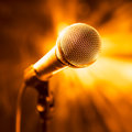 Golden microphone on stage Royalty Free Stock Photo