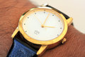 Golden modern wrist watch showing time as pm this photo represents concepts like punctuality deadlines management etc Stock Photo