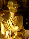 Golden monk statue Royalty Free Stock Photo