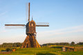 Golden morning light at a Dutch windmill Royalty Free Stock Photo