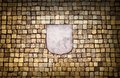 Golden mosaic wall with empty emblem element Royalty Free Stock Images