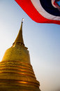 Golden moutain temple in bangkok twilight with thailand flag Royalty Free Stock Images