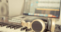 Golden Music Studio headphone lying on desktop Royalty Free Stock Photo