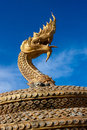 Golden naga snake in thailand statue on karon beach on phuket Royalty Free Stock Photography