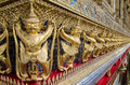 Golden nagas gold ornamental patter statuettes ancient sculpture works wat phra kaew temple of the emerald buddha is famous te in Royalty Free Stock Photos