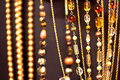 Golden necklaces and gems, shallow dof on black Royalty Free Stock Images
