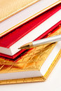 Golden notebook with pen Stock Image