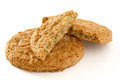 Golden oat biscuits broken in half Royalty Free Stock Photo
