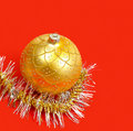 Golden ornament and garland on red Royalty Free Stock Images