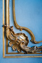 Golden ornament made from gold on a blue painted wall in ancient palace palace Stock Photos