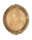 Golden oval photo frame with old brown canvas inside.Isolated. Royalty Free Stock Photo