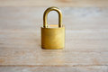 Golden padlock on wood background Royalty Free Stock Image