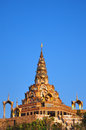 Golden pagoda in the blue sky background at wat prathatphasonkaew phetchabun province of thailand Stock Photos