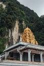 Golden pagoda with green mountain near Batu Caves near Kuala Lumpur, Malaysia. Royalty Free Stock Photo